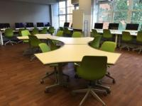 Modular tables and chairs in 312 Denney Hall