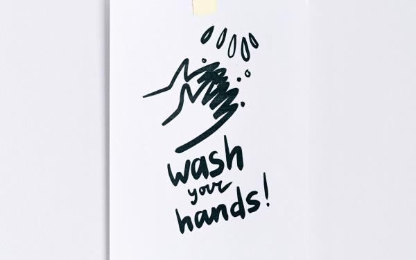 "Drawing of hands being washed with text ""Wash your Hands!"""