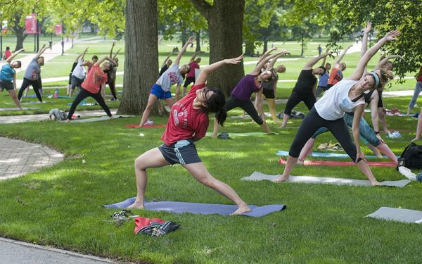 Group of people doing outdoor yoga